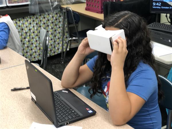 girl using VR headset